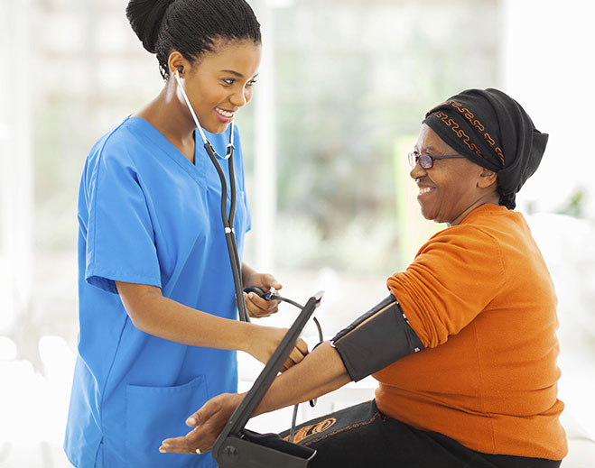 woman taking blood pressure